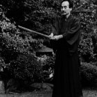 Practice with a wooden sword from Master Ueshiba