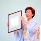 After receiving an award from URL, 2012